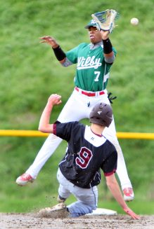 #7 Dario Sosa of Wilby High misses the throw as #9 Ben Smith of Torrington High slides into 2nd safe during NVL baseball action in Waterbury Monday. Steven Valenti Republican-American