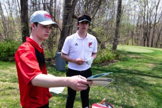 Northwestern's Josh Cichocki and Pomperaug's Tyler Flood, check their score cards with fellow players between holes during the Woodland Individual golf tournament held Thursday at Oxford Greens in Oxford. 20 schools from throughout the state completed in the tournament. Jim Shannon Republican American