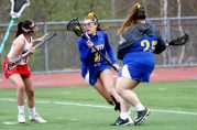 #8 Genevieve Bushey of Housatonic Valley Regional High heads to the goal around #4 Melony Albert of Wolcott High during Lacrosse action in Wolcott Thursday. #25 Kaylyn Vogel of Housatonic Valley Regional High at right. Steven Valenti Republican-American