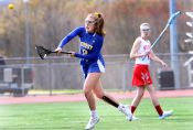 #8 Genevieve Bushey of Housatonic Valley Regional High takes a shot on goal against Wolcott High during Lacrosse action in Wolcott Thursday. Steven Valenti Republican-American