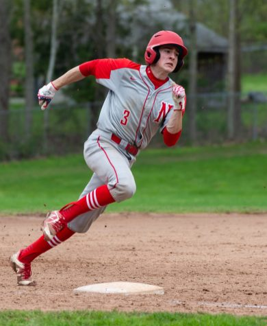 Northwestern's Joey Grantmeyer (3) round third to score, on a two-RBI hit by Alberto Cantalini (6) during their Berkshire League game against Lewis Mills Monday at Northwestern in Winsted. Jim Shannon Republican American