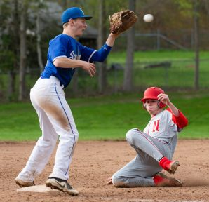 Northwestern's Wyatt Weber (33) safely steals third base in front of the tag by Lewis Mills' Devin Shaffer (2) during their Berkshire League game Monday at Northwestern in Winsted. Jim Shannon Republican American