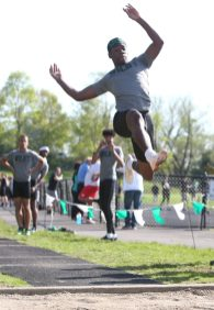 Wilby High School's Messiah Harling jumps 20 feet 1 inch in the long jump during the three school track meet between Wilby, Woodland, and Derby at Woodland Regional High School on Tuesday afternoon. Emily J. Reynolds. Republican-American