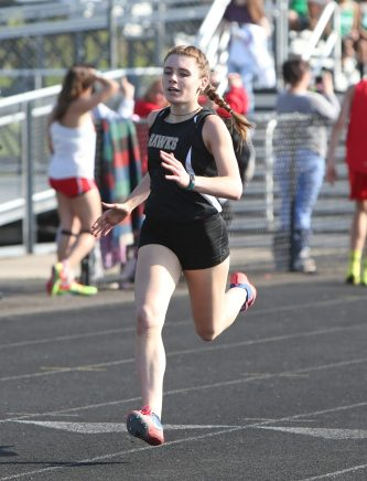 Woodland Regional High School's Jade Brennan wins the girls 400 meter race during the three school track meet between Wilby, Woodland, and Derby at Woodland Regional High School on Tuesday afternoon. Emily J. Reynolds. Republican-American