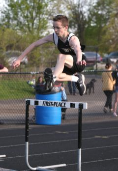 Woodland Regional High School's Aiden Kennedy comes in second in his heat of the boys hurdles during the three school track meet between Wilby, Woodland, and Derby at Woodland Regional High School on Tuesday afternoon. Emily J. Reynolds. Republican-American