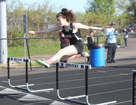 Woodland Regional High School's Hailey Bernier wins the first heat of the girls hurdles during the three school track meet between Wilby, Woodland, and Derby at Woodland Regional High School on Tuesday afternoon. Emily J. Reynolds. Republican-American