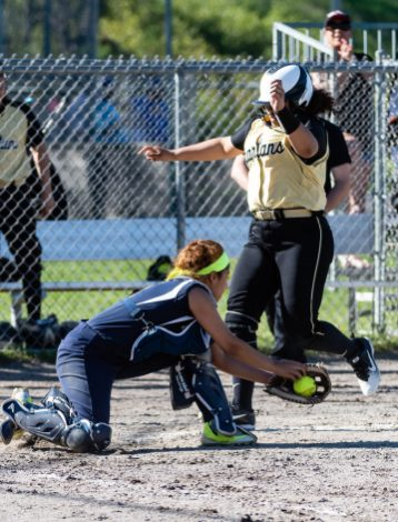 WCA's Joeva Jones #12, right, crosses the plate safely ahead of the tag by Kennedy's Shyan Perez #11, during a Girls NVL Softball game between WCA and Kennedy at Roberto Clemente Field in Waterbury on Wednesday. Bill Shettle Republican-American