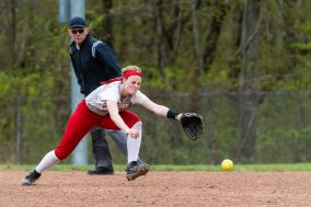 Wolcott's Katie Cosmos #7 dives to her left trying to get to a ground ball, during a Girls NVL softball game between Holy Cross and Wolcott at Wolcott High School in Wolcott on Thursday. Holy Cross held on to win 4-2. Bill Shettle Republican-American