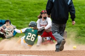Holy Cross' Carley DeFoe #26 slides safely into third ahead of the tag by Wolcott's Josie Cammarata #22, after hitting for a rbi triple, during a Girls NVL softball game between Holy Cross and Wolcott at Wolcott High School in Wolcott on Thursday. Holy Cross held on to win 4-2. Bill Shettle Republican-American
