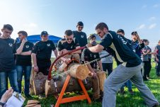 Woodland captain, senior Drek Jonikas saws through a log using a bow saw in the Boys Bow Saw competition during a Timber team competition between Wamogo and Woodland at Woodland Regional High School in Beacon Falls on Friday. Bill Shettle Republican-American
