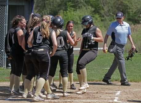 Woodland's Kylie Bulinski (12) is greeted by her teammates at home plate after she hit a home run against Saint Paul at Saint Paul Catholic High School in Bristol Saturday afternoon. Saint Paul defeated Woodland 17-14. Michael Kabelka / Republican-American
