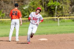Wolcott's Dane Hassan #3 rounds second base after hitting a two run home-run, during a NVL Baseball game between Watertown and Wolcott at Wolcott High School in Wolcott on Wednesday. Bill Shettle Republican-American
