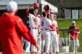 Wolcott's Dane Hassan #3 is congratulated at home plate by his teammates after hitting a two run home-run, during a NVL Baseball game between Watertown and Wolcott at Wolcott High School in Wolcott on Wednesday. Bill Shettle Republican-American
