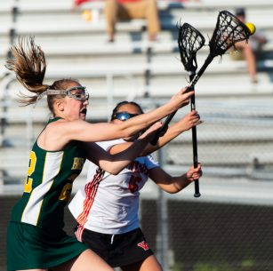 Holy Cross' Alyssa Hebb (22) and Watertown's Alyssa Perugini (16) battle for possession of the ball during their lacrosse match Wednesday at Watertown High School. Jim Shannon Republican American