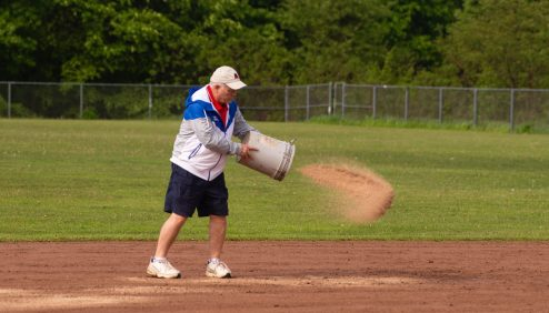 Northwestern Athletic Director Fred Williams, assists with spreading speedy dry to the field after a rain delay in the Northwestern vs Wamogo Berkshire League softball game Monday at Northwestern. Jim Shannon Republican American