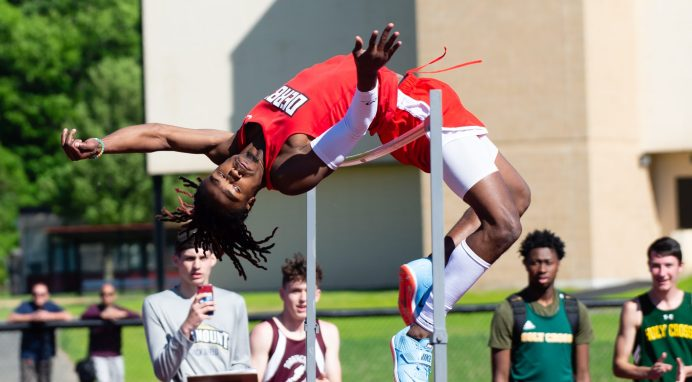 """Derby's Ja'Kwan Hale attempt to clear 6'10 1/4"""" for the NVL high jump record during the NVL Track and Field Championships held Tuesday at Torrington High School. Hale did not clear the height but won with a jump of 6'9"""" Jim Shannon Republican American"""
