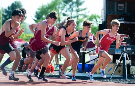 Runners take to the track as they compete in the 3200m run during the NVL Track and Field Championships held Tuesday at Torrington High School. Jim Shannon Republican American