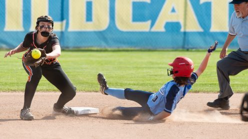 Oxford's Jenna Myers (0) slides safely into second base in front of the tag by Watertown's Morgan Hodorski (10) during their NVL tournament semifinal game Wednesday at Seymour High School. Jim Shannon Republican American