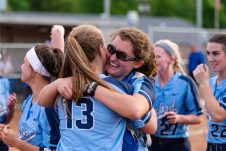Oxford catcher Kaylee Cuomo #2, gives a celebratory hug with her pitcher Sage Borkowski #13, after winning the Girls Softball NVL Championship game between Oxford and Seymour at Naugatuck High School in Naugatuck on Thursday. Oxford won in extra innings over Seymour 11-6 and wins the NVL Championship for 2019. Bill Shettle Republican-American