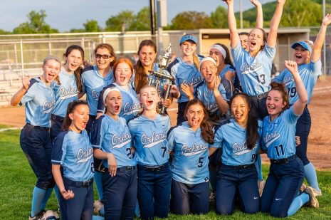 The Oxford Girls softball team celebrate together after winning the Girls Softball NVL Championship game between Oxford and Seymour at Naugatuck High School in Naugatuck on Thursday. Bill Shettle Republican-American