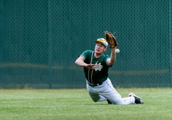 Holy Cross' Zach Lerner #23 dives trying to make a catch in the outfield, during the NVL championship game between Holy Cross and Wolcott at Municipal Stadium in Waterbury on Friday. Wolcott beat Holy Cross 10-3 to win the 2019 NVL Baseball Championship. Bill Shettle Republican-American