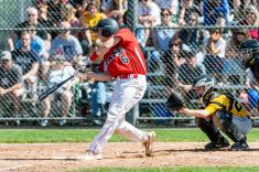 Cheshire's Matthew Costello #6 gets an rbi single to knock in the first run of the game, during the SCC championship game between Amity and Cheshire at Piurek Field in West Haven on Saturday. Bill Shettle Republican-American