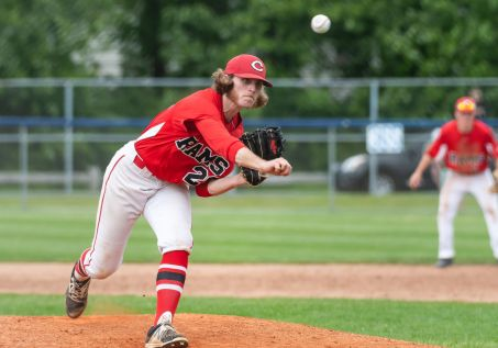 Cheshire pitcher Robert Roles #20 delivers a pitch from the mound, during the SCC championship game between Amity and Cheshire at Piurek Field in West Haven on Saturday. Bill Shettle Republican-American