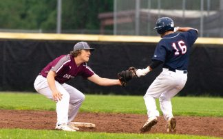 Naugatuck's Derrick Jagello (10) tags out McMahon's Cooper Grillo (16) as he tries to steals second base during their Class LL first round tournament game against Brien McMahon Tuesday at Naugatuck High School. Jim Shannon Republican American
