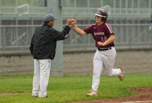 Naugatuck's Derrick Jagello (10) is congratulated by head coach Tom Deller as he rounds the bases after blasting a solo home run in the sixth inning of their 2-0 win over Brien McMahon Tuesday at Naugatuck High School. Jim Shannon Republican American
