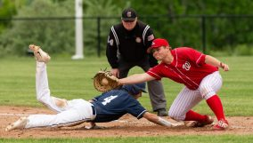 Oxford's Matt Michaud (4) dives back to first in front of the tag by Wamogo's Ryan McCarthy (23) on a pick off play during their Class S tournament game Wednesday at Oxford High School. Jim Shannon Republican American