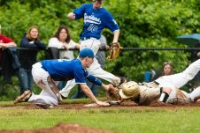 Woodland's Nick DeLucia #18, right, dives safely into third ahead of the tag by Lewis Mills' Devin Shaffer #2, as Lewis Mills' Blair Harris #10 looks on, during the CIAC 2019 State Baseball Tournament Class M Quarterfinals between Lewis Mills and Woodland at Woodland Regional High School in Beacon Falls on Thursday. Bill Shettle Republican-American