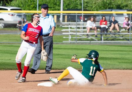 Holy Cross' Allie Brown (1) slides into second base safely on a fielders choice as Coginchaug's Amalia DeMartino (8) looks on during their Class S semi-final game Monday at West Haven High School. Jim Shannon Republican American