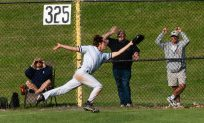 Shepaug's Jack Pesce make a running catch in foul territory for the out during their Class S semifinal game against Holy Cross Tuesday at Sage Park in Berlin. Jim Shannon Republican American