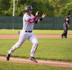 Shepaug's Ethan Hibbard (3) celebrates as he comes in to score the go-ahead run during their Class S semifinal game against Holy Cross Tuesday at Sage Park in Berlin. Jim Shannon Republican American Jim Shannon Republican American
