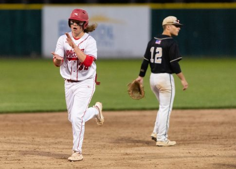 Wolcott's Trey Nastri (32) celebrates while moving over to third base on a balk call against Woodland's Justin Butterworth during their Class M semifinal game Tuesday at Muzzy Field in Bristol. Jim Shannon Republican American