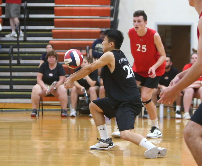 Cheshire High School's Berkley Fang bumps the ball as Cheshire battles Newington High School for the Class M boys volleyball title at Shelton High School on Thursday, June 6, 2019. Emily J. Reynolds. Republican-American