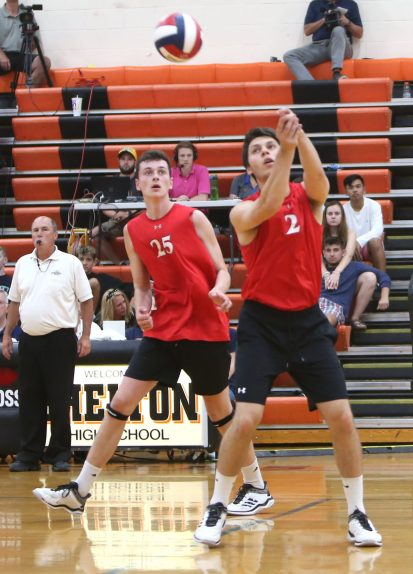 Cheshire High School's Luke Pinciaro bumps the ball in front of teammate Colby Hayes as Cheshire battles Newington High School for the Class M boys volleyball title at Shelton High School on Thursday, June 6, 2019. Emily J. Reynolds. Republican-American