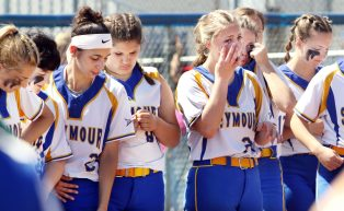 Seymour waits for the runner up trophy as #20 Molly Adamo of Seymour High wipes away tears after the loss to Waterford during the CIAC Class M softball final in West Haven Saturday. Steven Valenti Republican-American