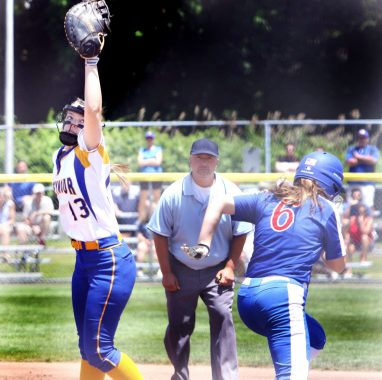 Reilly Bronson of Seymour High gets the late throw to first as #6 Ciana Chiappone cross the bag safe during the CIAC Class M softball final in West Haven Saturday. Steven Valenti Republican-American