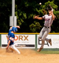 Wolcott's Jacob Daniels (2) safely steals second as South Troy's Matt Tiberia (5) has to go up for the throw during their Mickey Mantle World Series game Thursday at Municipal Stadium in Waterbury. Jim Shannon Republican-American