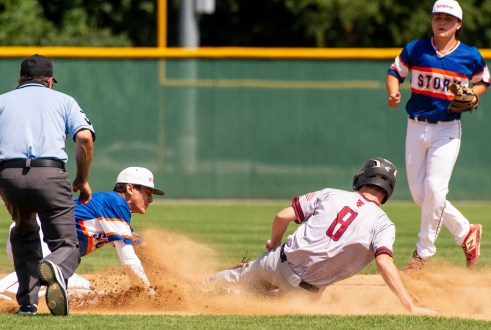 South Troy's Patrick Walters (8) is called safe at second base after the ball popped out of the glove of Wolcott's Cameron Maldonado (3) during their Mickey Mantle World Series game Thursday at Municipal Stadium in Waterbury. Jim Shannon Republican-American