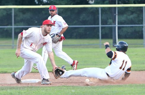 Albany Athletics shortstop Cam Overbaugh tries to tag Terryville Black Sox second baseman Joe Poletsky out at second base during the game at Fuessenich Park on Thursday night. Emily J. Tilley. Republican-American