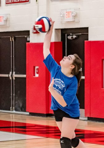 Lewis Mills' Natalie Hamel serves the ball, during a girls volleyball scrimmage between Lewis Mills and Pomperaug at Pomperaug High School in Southbury on Thursday. Bill Shettle Republican-American