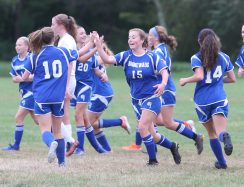 Nonnewaug High School's girls varsity soccer players, including Danielle Forte, center, celebrate scoring a goal during the game against Northwestern High School in Hollow Park on Thursday afternoon. Emily J. Reynolds. Republican-American