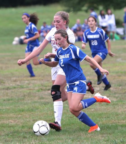 Nonnewaug High School's Alexa Burke battles Northwestern High School's Sierra Murphy for the ball during the girls varsity soccer game in Hollow Park on Thursday afternoon. Emily J. Reynolds. Republican-American