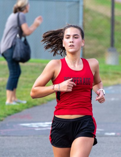 Pomperaug's Charlotte Brehmer comes to the finishing stretch in their cross country meet with Bunnell, Joel Barlow and Notre Dame-Fairfield Tuesday at Pomperaug High School. Jim Shannon Republican-American