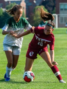 Taft's Susanna Adams (16) and Sacred Heart-Greenwich's Chelsea Hyland (22) battle for the ball during their game Wednesday at the Taft School in Watertown. Taft defeated Sacred Heart 3-1. Jim Shannon Republican-American
