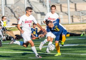 Kennedy's Htoo Sher Eh #11, right, scores a goal in front of Wolcott's Michael DosSantos #7 defending, during a non league soccer match between Wolcott and Kennedy at Kennedy High School on Monday. Bill Shettle Republican-American