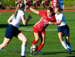 Wolcott's Morgan Matyoka (19) fights off Oxford's Grace Mahmood (2), right, and Paige Davis (34), left, to gain control of the ball during their game Tuesday at Wolcott High School Jim Shannon Republican-American