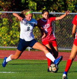Oxford's Jess Kondic (8) and Wolcott's Emiah Soto (8) battle for the ball during their game Tuesday at Wolcott High School Jim Shannon Republican-American